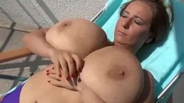 MILF Playing With Her Monster Tits In The Sun